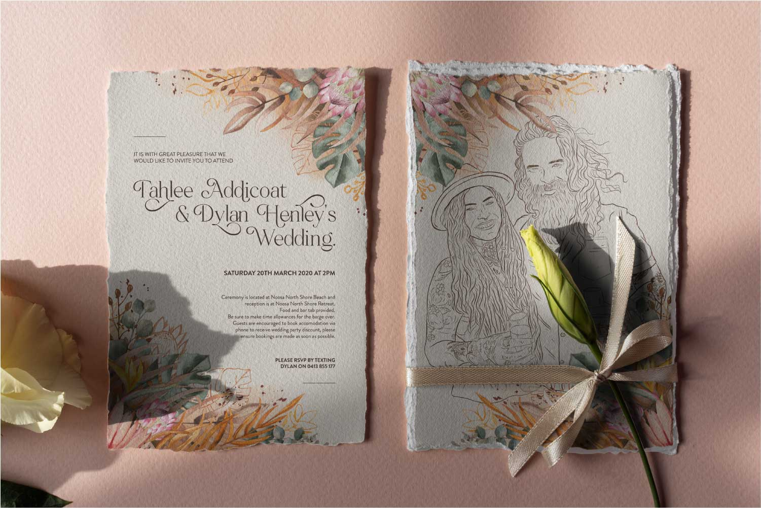T and D Invitations on table with flower